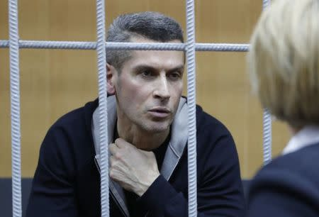 Ziyavudin Magomedov, the co-owner of Russia's Summa investment and trading group that was involved in construction of a soccer World Cup venue in Kaliningrad, talks with a lawyer during a hearing on his detention at the Tverskoy District Court in Moscow, Russia March 31, 2018. REUTERS/Tatyana Makeyeva