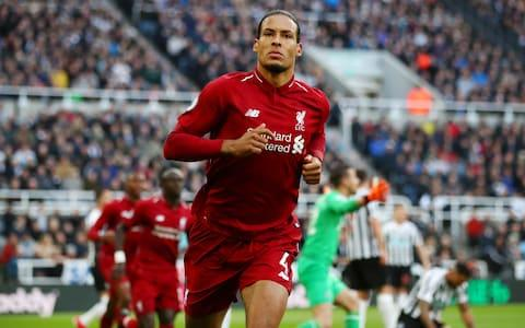 Virgil van Dijk of Liverpool celebrates after scoring his team's first goal during the Premier League match between Newcastle United and Liverpool FC - Credit: GETTY IMAGES