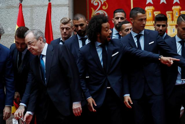 Soccer Football - Real Madrid celebrate winning the Champions League Final - Madrid, Spain - May 27, 2018 Real Madrid's Marcelo celebrates with president Florentino Perez during ceremony REUTERS/Javier Barbancho