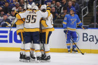 The Nashville Predators celebrate a goal against the St. Louis Blues as Blues' Brayden Schenn (10) looks at the scoreboard during the first period of an NHL hockey game Saturday, Nov. 23, 2019, in St. Louis. (AP Photo/Dilip Vishwanat)