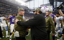 Minnesota Vikings head coach Mike Zimmer, front left, greets Detroit Lions head coach Matt Patricia after an NFL football game, Sunday, Nov. 4, 2018, in Minneapolis. (AP Photo/Bruce Kluckhohn)