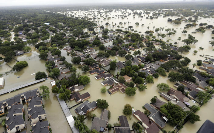 <p>Water from Addicks Reservoir flows into neighborhoods as floodwaters from Tropical Storm Harvey rise Tuesday, Aug. 29, 2017, in Houston. (Photo: David J. Phillip/AP) </p>
