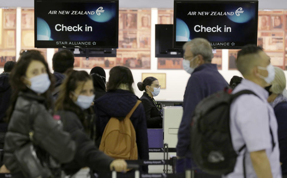 Passengers prepare at Sydney Airport, in Sydney, Australia, Monday, April 19, 2021, to catch a flight to New Zealand as the much-anticipated travel bubble between Australia and New Zealand opens. (AP Photo/Rick Rycroft)