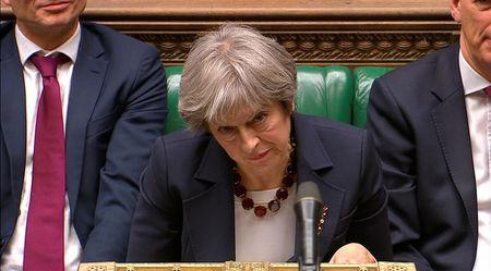 Britain's Prime Minister Theresa May reacts as the leader of the Labour Party Jeremy Corbyn responds to her address to the House of Commons on her government's reaction to the poisoning of former Russian intelligence officer Sergei Skripal and his daughter Yulia in Salisbury, in London, March 14, 2018. Parliament TV handout via REUTERS