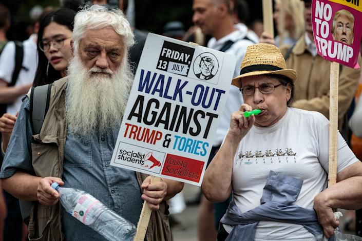 <p>Protesters chant and wave placards during a demonstration outside Winfield House, the London residence of U..S Ambassador Woody Johnson, where President Donald Trump and first lady Melania Trump are staying tonight on July 12, 2018 in London, Britain. (Photo: Jack Taylor/Getty Images) </p>