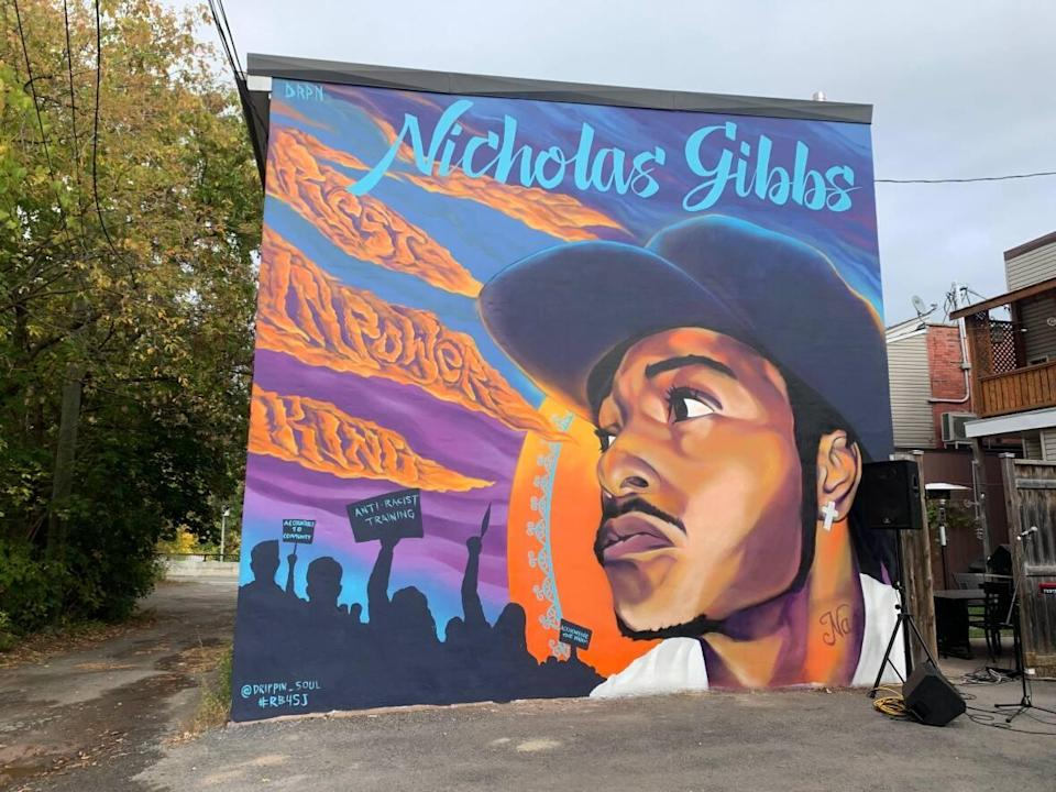 Nicholas Gibbs, represented in a new Montreal mural, was fatally shot by police in the neighbourhood of N.D.G. in the summer of 2018, when he was 23. (Chloe Ranaldi/CBC - image credit)