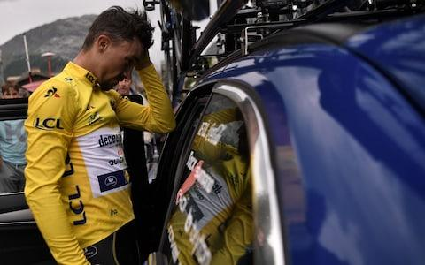 Julian Alaphilippe looks disconsolate after losing his yellow jersey - Credit: afp