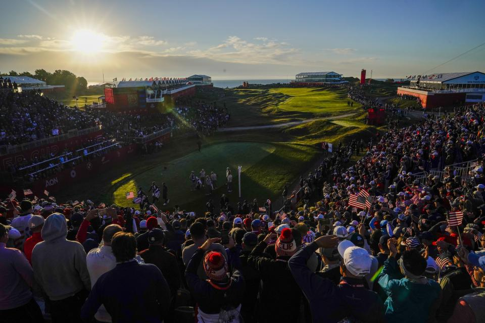 Players tee off on the first hole as the sun rises during a foursomes match the Ryder Cup at the Whistling Straits Golf Course Saturday, Sept. 25, 2021, in Sheboygan, Wis. (AP Photo/Ashley Landis)