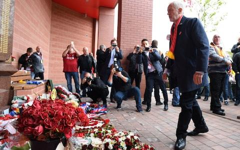 Labour leader Jeremy Corbyn visits the Hillsborough memorial at Anfield in Liverpool before he attends the match between Liverpool and Southampton - Credit: Stefan Rousseau/PA Wire