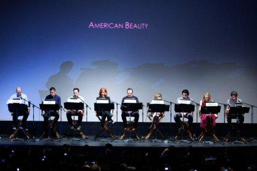 "(L-R) Paul Scheer, George Stroumboulopoulos, Nick Kroll, Christina Hendricks, Bryan Cranston, Mae Whitman, Adam Driver, Sarah Gadon and Jason Reitman on stage at the Jason Reitman all-star cast live table read of Alan Ball's screenplay for ""American Beauty"" during the 2012 Toronto International Film Festival on September 6, 2012 in Toronto, Canada"