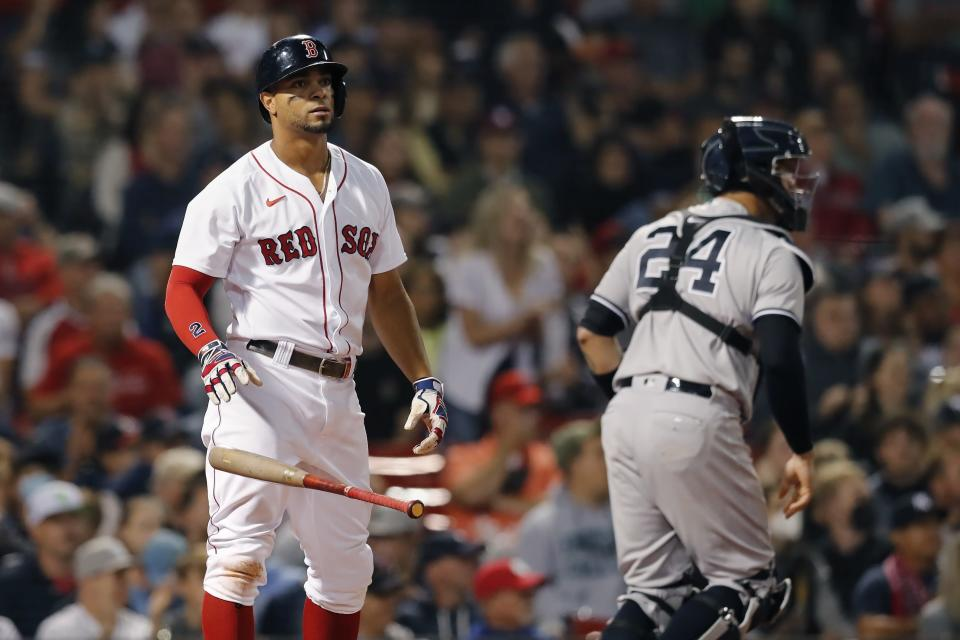 Boston Red Sox's Xander Bogaerts drops the bat after striking out swinging as New York Yankees' Gary Sanchez (24) heads to the dugout during the first inning of a baseball game, Sunday, Sept. 26, 2021, in Boston. (AP Photo/Michael Dwyer)