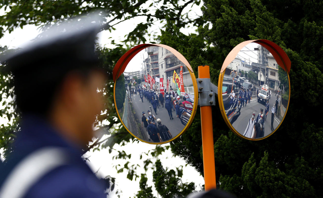 <p>Protesters are reflected on curved mirrors during an anti-G-7 summit rally in Tsu, central Japan, near Shima where the Group of Seven leaders are holding meetings, May 26, 2016. (AP Photo/Shizuo Kambayashi) </p>