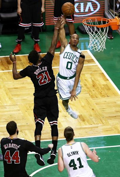 Avery Bradley of the Boston Celtics takes a shot against Jimmy Butler of the Chicago Bulls in Game Five of the Eastern Conference quarter-finals, at TD Garden in Boston, Massachusetts, on April 26, 2017