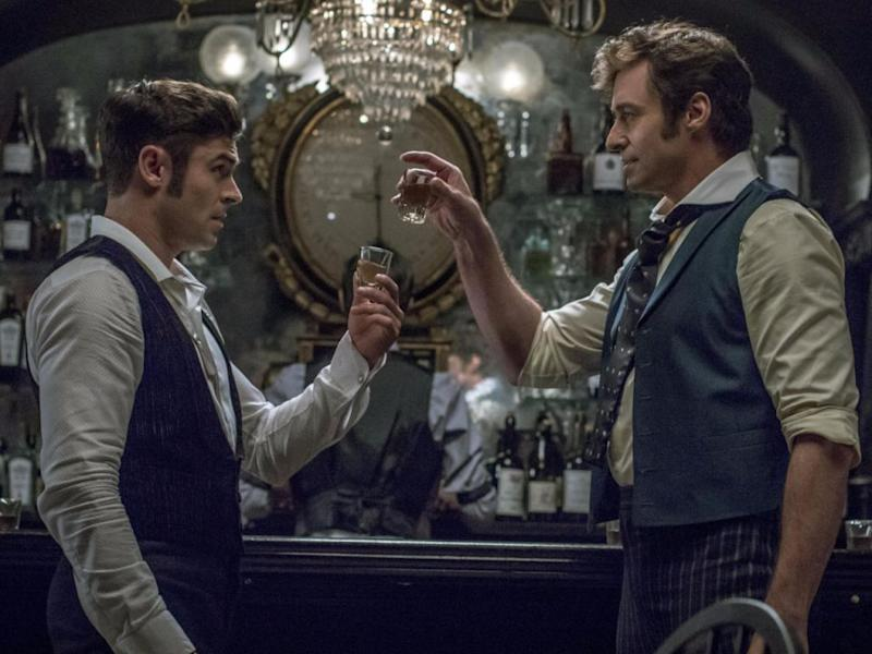 The movie stars mega babes Hugh Jackman and Zac Effron, who are both a part of the legendary circus being born. Source: 20th Century Fox