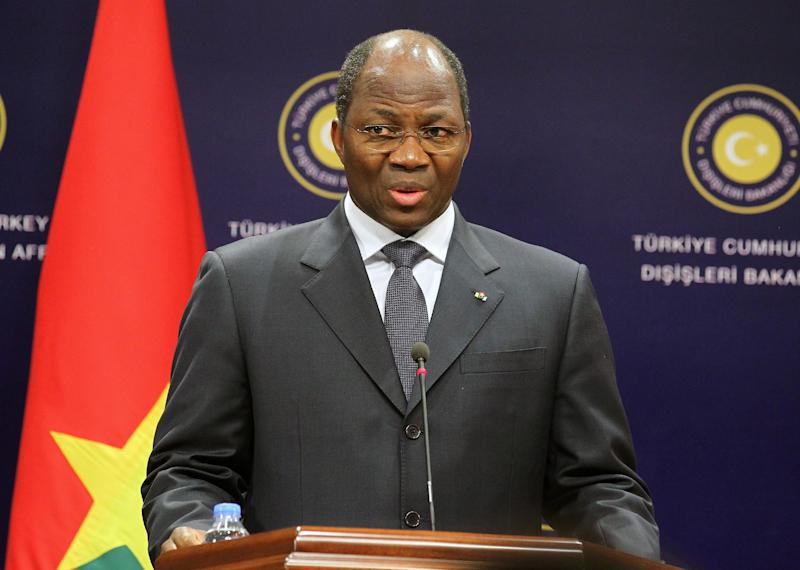 This photo made available by the Turkish Foreign Ministry shows the foreign minister of Burkino Faso, Djibril Yipene Bassole, speaking to the media shortly before Bassole briefly passed out during a live televised news conference with Turkish Foreign Minister, Ahmet Davutoglu, unseen, in Ankara, Turkey, Thursday, May 9, 2013. Bassole leaned toward the lectern in front of him before knocking it over and collapsing on the raised platform. (AP Photo/Turkish Foreign Ministry, Cengiz Oguz Gumrukcu)