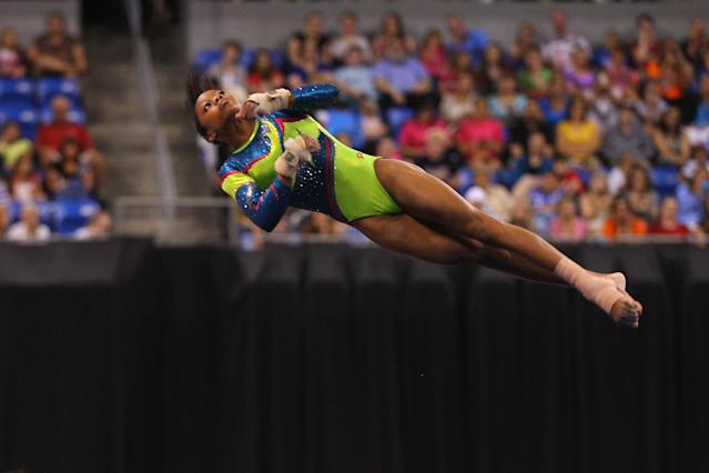 ST. LOUIS, MO - JUNE 10: Gabrielle Douglas competes in the floor event during the Senior Women's competition on day four of the Visa Championships at Chaifetz Arena on June 10, 2012 in St. Louis, Missouri. (Photo by Dilip Vishwanat/Getty Images)