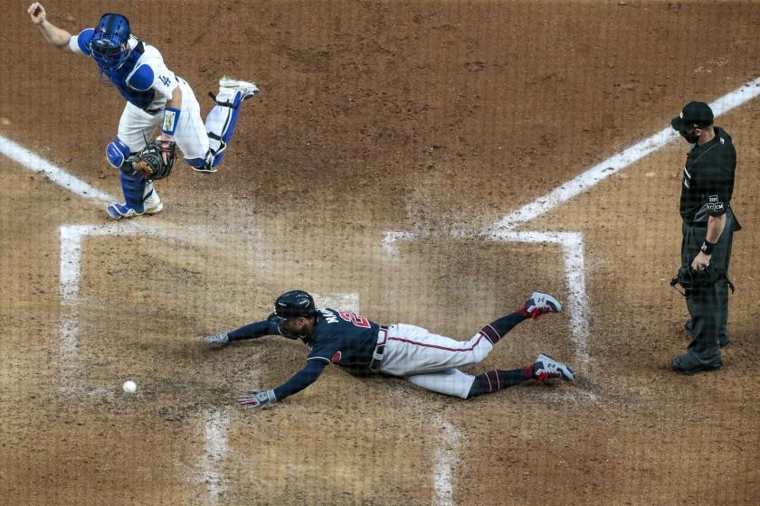 Arlington, Texas, Tuesday, October 13, 2020. Nick Markakis scores on a Christian Pache double in the fifth inning in game two of the NLCS at Globe Life Field. (Robert Gauthier/ Los Angeles Times)