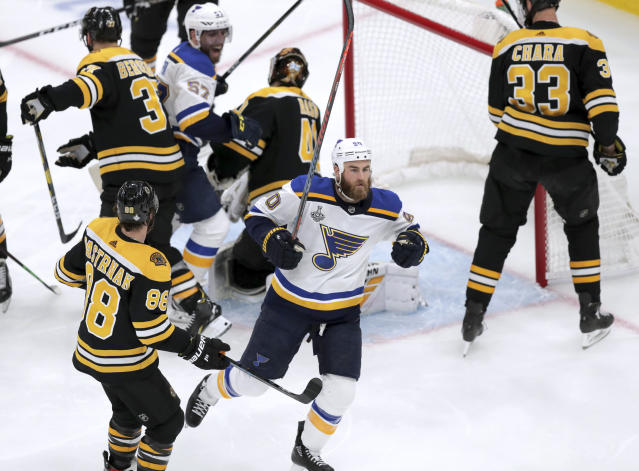 St. Louis Blues' Ryan O'Reilly, front, celebrates his goal against the Boston Bruins during the second period in Game 5 of the NHL hockey Stanley Cup Final, Thursday, June 6, 2019, in Boston. (AP Photo/Charles Krupa)