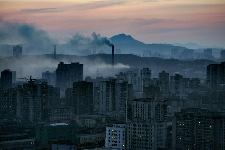 Steam clouds from coal powered power plants float above Pyongyang, which is struggling under the weight of economic sanctions