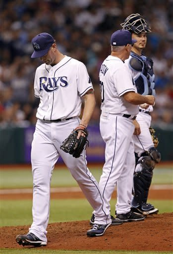 Tampa Bay Rays relief pitcher Kyle Farnsworth, left, is removed by manager Joe Maddon, center, who talks to catcher Jose Lobaton during the eighth inning of a baseball game against the New York Yankees, Wednesday, July 4, 2012, in St. Petersburg, Fla. The Yankees won 4-3. (AP Photo/Mike Carlson)