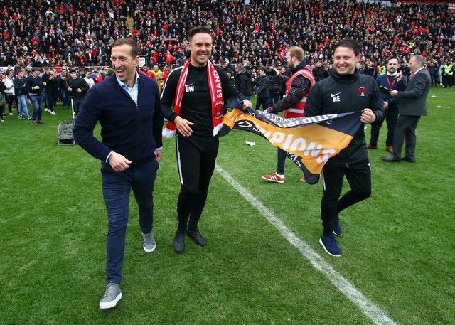 Ross Embleton, right, with Justin Edinburgh, left, and Danny Webb after Leyton Orient secured the Vanarama National League title in April 2019