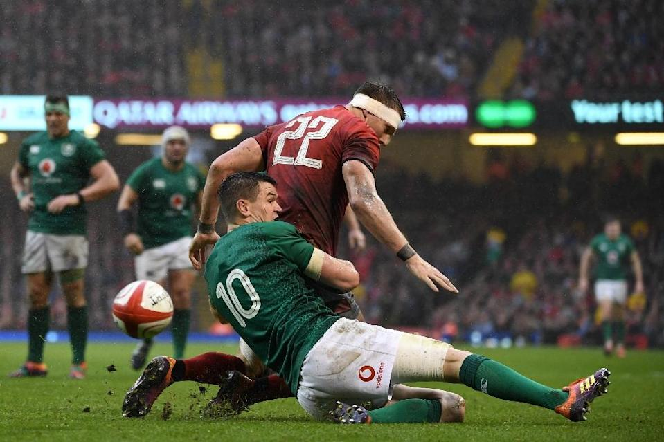 Johnny Sexton's grumpiness and poor form which has dogged the world player of the year at the Six Nations reached a nadir in the 25-7 thumping by Wales (AFP Photo/Paul ELLIS)