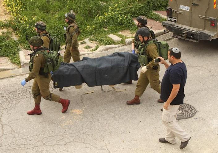 The Israeli soldier -- who last week shot the Palestinian in the head while he was lying prone on the ground -- has been arrested and strongly condemned by top military officials (AFP Photo/Hazem Bader)
