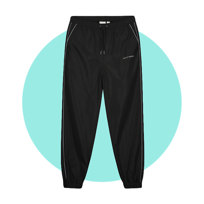 """$132, Daily Paper. <a href=""""https://www.dailypaperclothing.com/collections/pants/products/black-etrack-pants?variant=34681843155078"""" rel=""""nofollow noopener"""" target=""""_blank"""" data-ylk=""""slk:Get it now!"""" class=""""link rapid-noclick-resp"""">Get it now!</a>"""