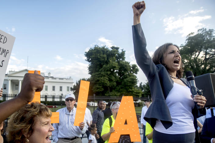 Center for American Progress President Neera Tanden speaks at a protest outside the White House on July 17, 2018, in Washington. (Andrew Harnik / AP file)
