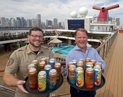 Colin Presby, left, Carnival Cruise Line's brewmaster, and Edward Allen, right, Carnival's vice president of beverage operations show trays of the line's new craft beer cans aboard Carnival Magic Sunday, March 17, 2019, at PortMiami. The line has partnered with Lakeland, Fla.-based Brew Hub to become the first cruise line to can and keg its own private label beers, first created by its in-house brewery team aboard Carnival Vista and Carnival Horizon. The beers include ThirstyFrog Caribbean Wheat, ParchedPig West Coast IPA and ParchedPig Toasted Amber Ale. (Photo by Andy Newman/Carnival Cruise Line)