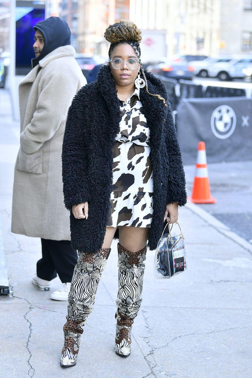 <p>Cow hide spots, zebra-printed cowboy boots – this look is like a how-to for fall fierceness. Go for animal prints that give off that urban cowgirl look.<br><br></p>