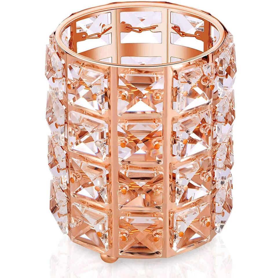 <p>The <span>YIVIYAR Rose Gold Makeup Organizer Holder</span> ($10) will not only look chic on your vanity but will hold your makeup and tools for a mess-free environment.</p>