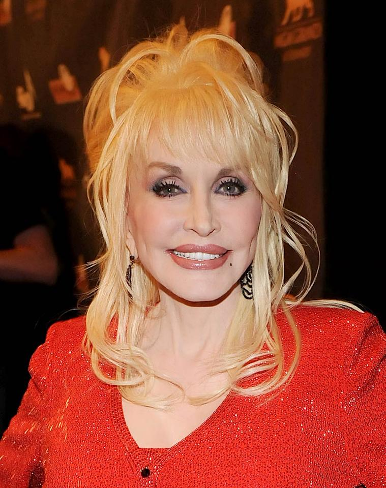 """<b>2010:</b> """"I'm in the public eye, so I don't care who knows what I get done,"""" the ageless Parton said of her beauty regimen. """"If I see something sagging, dragging or bagging, I get it sucked, tucked or plucked. It takes a lot of money to look as cheap as I look."""" Rick Diamond/<a href=""""http://www.gettyimages.com/"""" target=""""new"""">GettyImages.com</a> - April 10, 2010"""