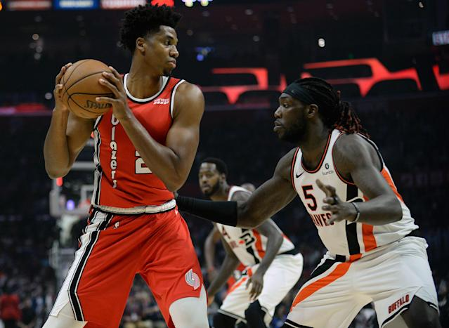 Blazers center Hassan Whiteside (21) controls the ball against Clippers forward Montrezl Harrell on Thursday at Staples Center. (Gary A. Vasquez-USA TODAY Sports)