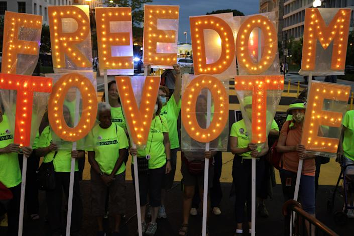 Voting rights activists march in Black Lives Matter Plaza in Washington DC on 17 July. (Getty Images)