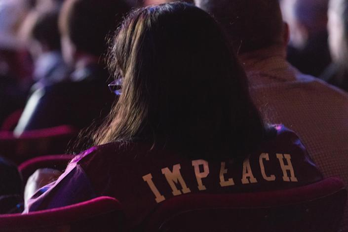 "A guest in the audience wears an ""Impeach"" jacket at the ""People's State of the Union"" at the Town Hall theater in New York City on Jan. 29, 2018. (Photo: Cheriss May/NurPhoto)"