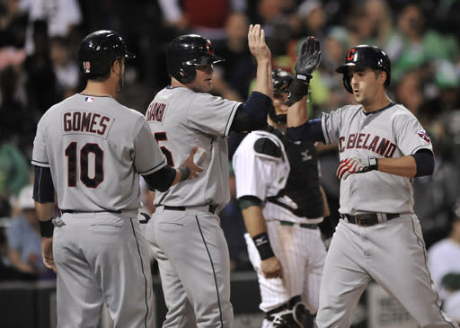 Cleveland Indians' Lonnie Chisenhall right, celebrates with teammate Jason Giambi (25) at home plate after hitting a three-run home run during the fourth inning of a baseball game against the Chicago White Sox in Chicago, Saturday, Sept. 14, 2013. (AP Photo/Paul Beaty)