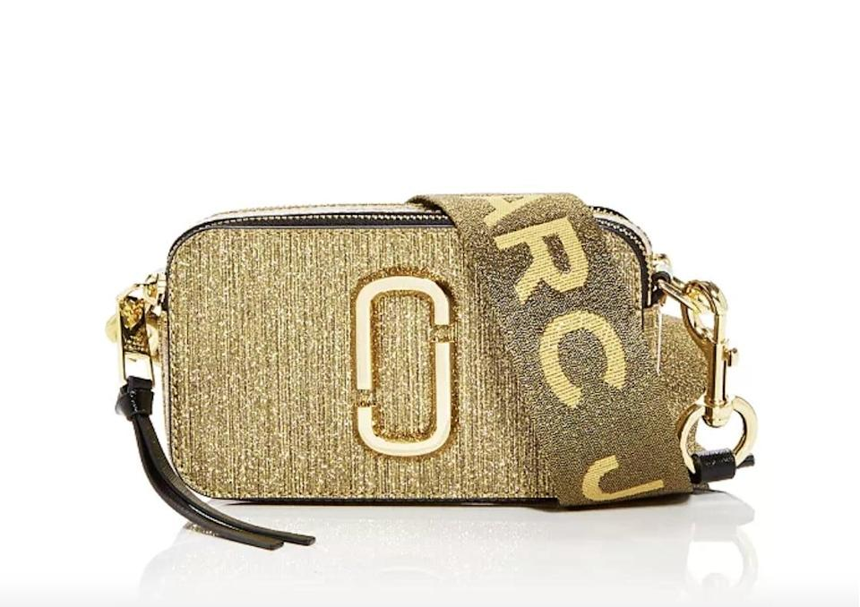 <p>This <span>Marc Jacobs Snapshot Glitter Leather Crossbody Bag</span> ($325) goes with everything.</p>