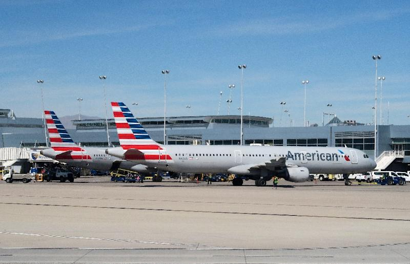 American Airlines said the flight attendant seen shouting in a viral video has been removed from duty while it investigates the incident
