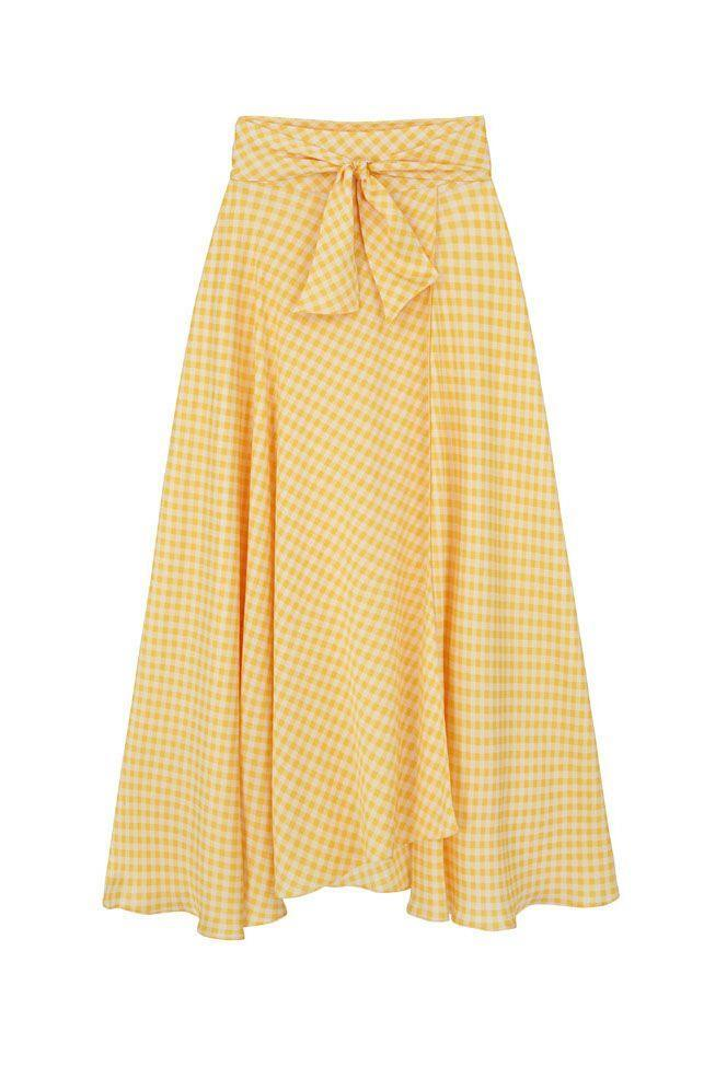 """<p><a class=""""link rapid-noclick-resp"""" href=""""https://www.harmur.co.uk/product/the-midi-wrap-skirt-yellow-gingham/"""" rel=""""nofollow noopener"""" target=""""_blank"""" data-ylk=""""slk:SHOP NOW"""">SHOP NOW</a></p><p>Harmur's silk wrap skirt moves beautifully, creating a holiday-like, breezy appeal wherever you are. Style yours with a simple T-shirt and espadrilles for a summer-ready look.</p><p>Gingham silk skirt, £295, <a href=""""https://www.harmur.co.uk/product/the-midi-wrap-skirt-yellow-gingham/"""" rel=""""nofollow noopener"""" target=""""_blank"""" data-ylk=""""slk:Harmur"""" class=""""link rapid-noclick-resp"""">Harmur</a></p>"""