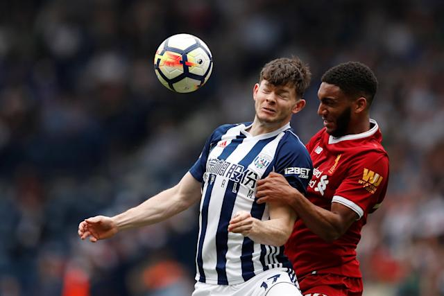 """Soccer Football - Premier League - West Bromwich Albion v Liverpool - The Hawthorns, West Bromwich, Britain - April 21, 2018 Liverpool's Joe Gomez in action with West Bromwich Albion's Oliver Burke Action Images via Reuters/Andrew Boyers EDITORIAL USE ONLY. No use with unauthorized audio, video, data, fixture lists, club/league logos or """"live"""" services. Online in-match use limited to 75 images, no video emulation. No use in betting, games or single club/league/player publications. Please contact your account representative for further details."""