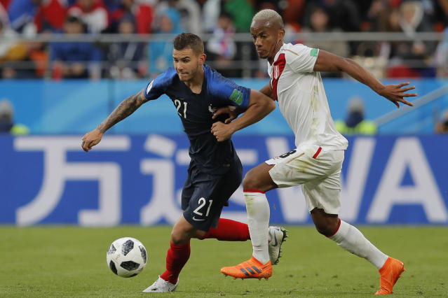 France's Lucas Hernandez, left, and Peru's Andre Carrillo compete for the ball during the group C match between France and Peru at the 2018 soccer World Cup in the Yekaterinburg Arena in Yekaterinburg, Russia, Thursday, June 21, 2018. (AP Photo/Vadim Ghirda)