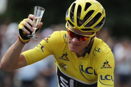 FILE PHOTO: Cycling - Tour de France cycling race - The 113-km (70,4 miles) Stage 21 from Chantilly to Paris, France, July 24, 2017. Yellow jersey leader Team Sky rider Chris Froome of Britain holds a glass of champagne after the start.  REUTERS/Kenzo Tribouillard/Pool/File Photo