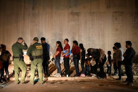Migrant families turn themselves to U.S. Border Patrol to seek asylum following an illegal crossing of the Rio Grande in Hidalgo