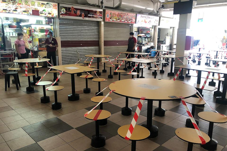 Cordoned off seats seen at the Empress Market and Food Centre on 16 April 2020, Day 10 of Singapore's partial lockdown. (PHOTO: Dhany Osman / Yahoo News Singapore)