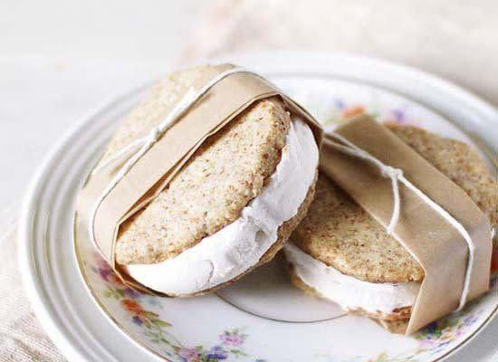 """Coconut flavored ice cream hits the spot on a hot day -- it's cool and refreshing. And there's no better way to enjoy it then sandwiched between two brightly-flavored lemon cookies. <strong>Get the <a href=""""http://goodthingsgrow.com/lemon-almond-coconut-ice-cream-sandwiches/"""" rel=""""nofollow noopener"""" target=""""_blank"""" data-ylk=""""slk:Lemon Almond Coconut Ice Cream Sandwiches"""" class=""""link rapid-noclick-resp"""">Lemon Almond Coconut Ice Cream Sandwiches</a> recipe by Good Things Grow</strong>"""