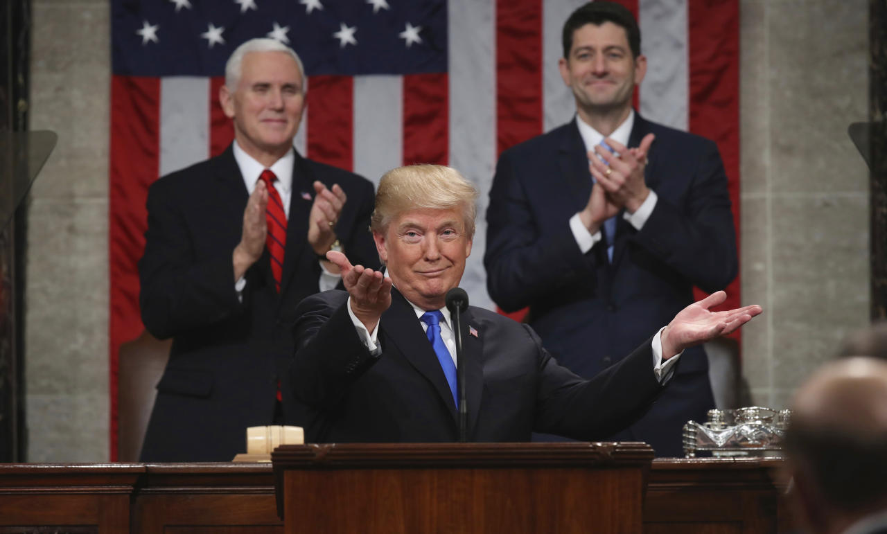 <p>Trump gestures as he delivers his first State of the Union address to a joint session of Congress on Jan. 30, as Vice President Mike Pence, left, and House Speaker Paul Ryan applaud. (Photo: Win McNamee/AP) </p>
