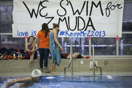 A sign supporting former Eastside Catholic High School Vice Principal and swimming coach Mark Zmuda is pictured during a swim meet at Rainier Beach Pool in Seattle, Washington, December 20, 2013. REUTERS/David Ryder