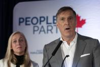 People's Party of Canada Leader Maxime Bernier speaks to supporters after he lost the election in his riding, Monday, October 21, 2019 in Beauceville, Que. Bernier's wife, Catherine Letarte, left, looks on. THE CANADIAN PRESS/Jacques Boissinot