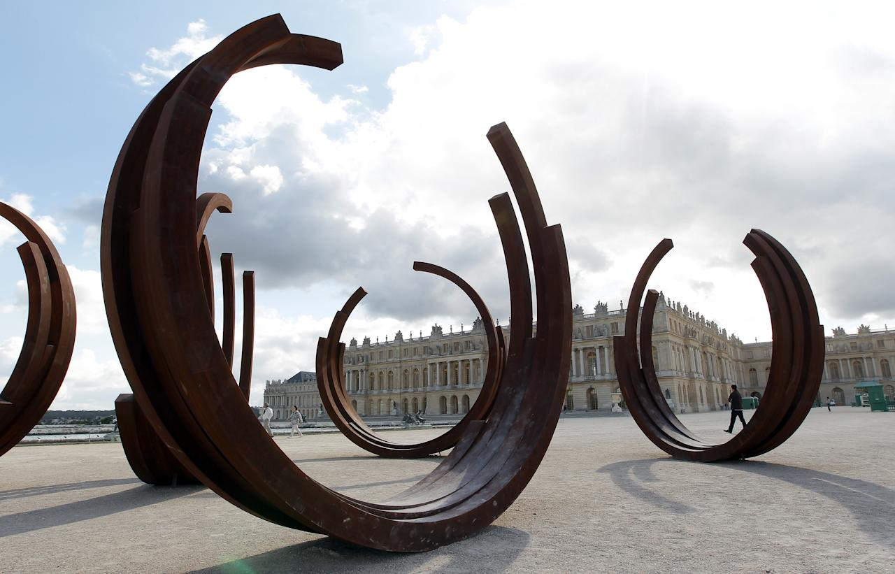 A monumental sculpture of the french artist Bernar Venet in the Versailles Palace gardens, west of Paris, Friday May 27, 2011. Venet is an internationally recognized painter, sculptor, and composer of concrete music. The event runs from June 1st to November 1st, 2011. (AP Photo Bob Edme)